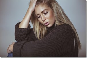 Contemplative young woman in sweater